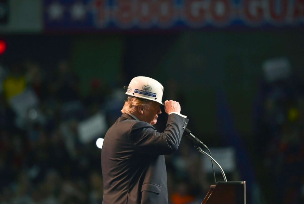 PHOTO: Republican presidential candidate Donald Trump wears a coal miners hat while addressing his supporters during a rally at the Charleston Civic Center on May 5, 2016 in Charleston, WVa.