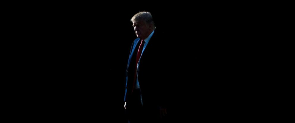PHOTO: President Donald Trump walks to Marine One on the South Lawn of the White House Dec. 20, 2017 in Washington, D.C.