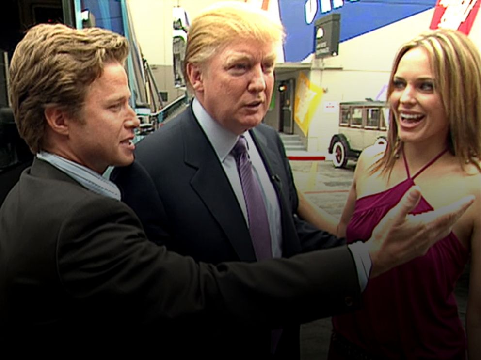 PHOTO: In this 2005 frame from video, Donald Trump prepares for an appearance on Days of Our Lives with actress Arianne Zucker, right. He is accompanied to the set by Access Hollywood host Billy Bush, left.