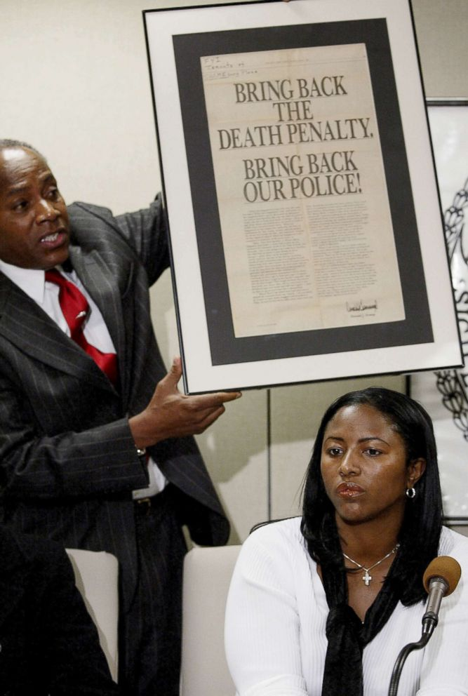 Angela Cuffie meets reporters at Manhattan Supreme Court where a judge overturned the conviction of her brother, Kevin Richardson, and four other men who had been jailed in the Central Park jogger case. Behind Cuffie, Councilman Bill Perkins (D-Harlem) holds up an advertisement taken out by Donald Trump after the crime.
