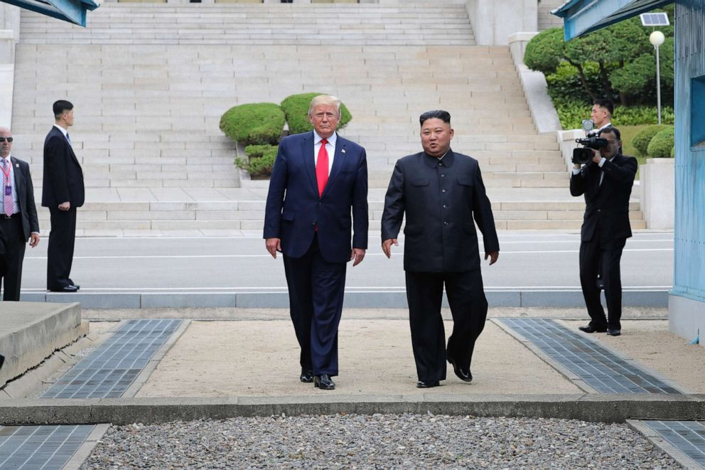 PHOTO: North Korean leader Kim Jong Un and President Donald Trump inside the demilitarized zone (DMZ) separating the South and North Korea, June 30, 2019.