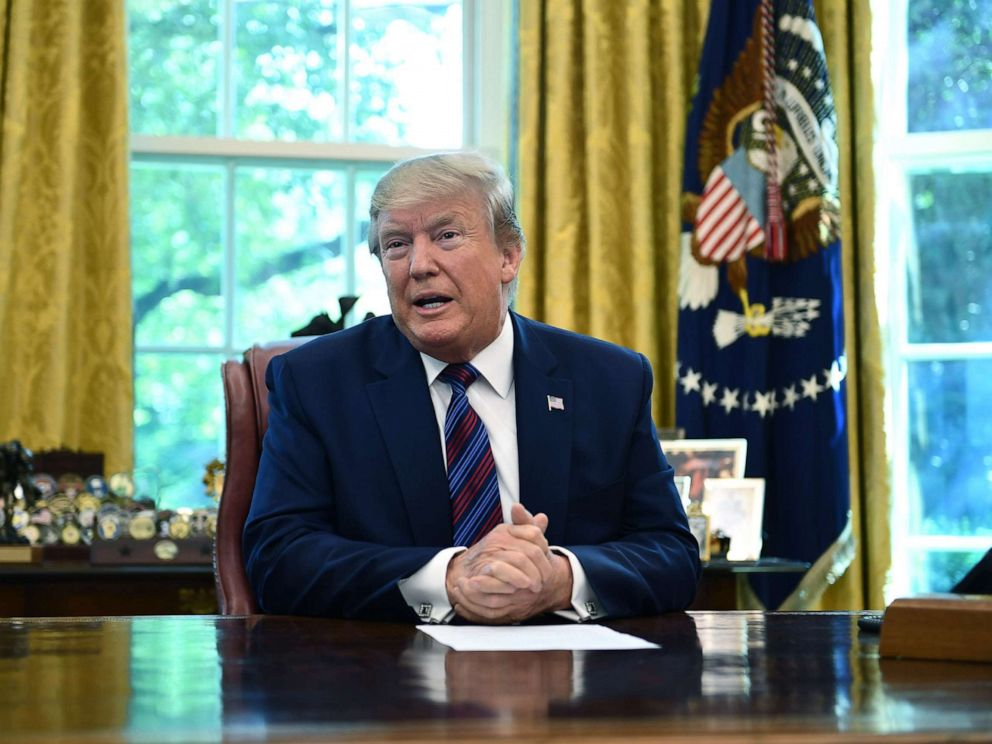 PHOTO: President Donald Trump speaks to the media in the Oval Office of the White House, July 26, 2019.