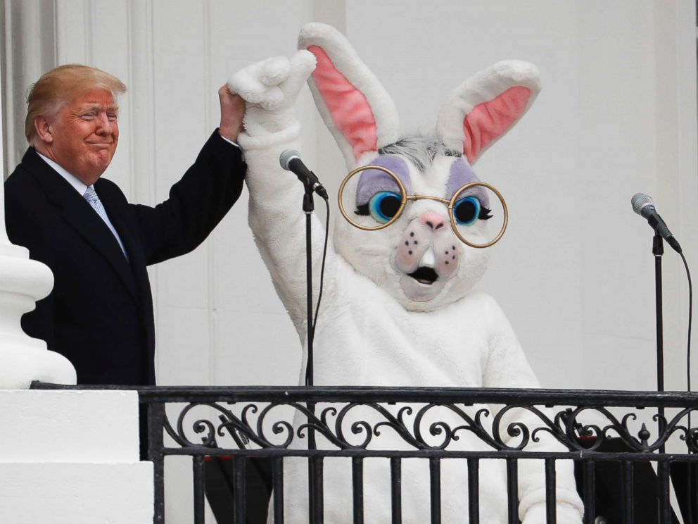 PHOTO: President Donald Trump and the Easter Bunny, after speaking to the crowd on the Truman Balcony during the annual White House Easter Egg Roll on the South Lawn of the White House in Washington, April 2, 2018.