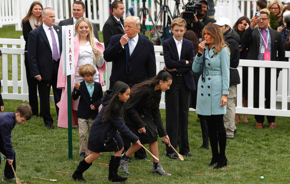 PHOTO: President Donald Trump and first lady Melania Trump blow whistles for children gathered for the annual White House Easter Egg Roll with his daughter Tiffany and son Barron on the South Lawn of the White House in Washington, April 2, 2018.