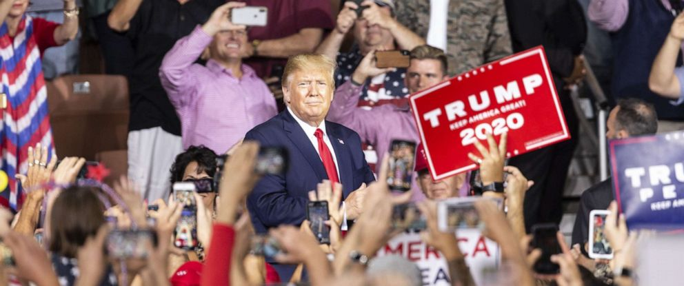 PHOTO: President Donald Trump greets supporters during campaign MAGA (Make America Great Again) rally at Southern New Hampshire University Arena, in Manchester, N.H. on Aug. 15, 2019.