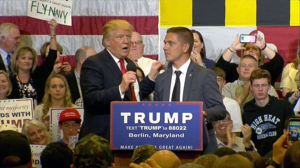 Presidential candidate Donald Trump invites Kevin Chmielewski on stage during a campaign rally in Berlin, Md., April 2017.