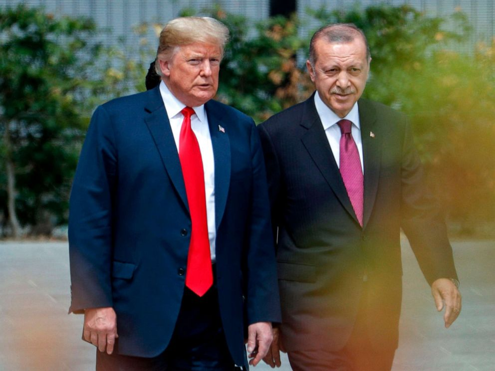 PHOTO: President Donald Trump speaks to Turkeys President Recep Tayyip Erdogan during the opening ceremony of the NATO summit at the NATO headquarters in Brussels.