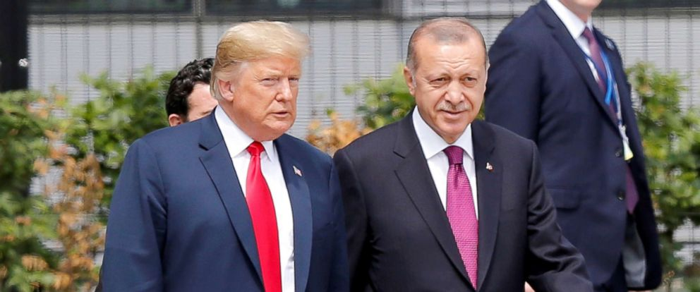 PHOTO: Turkish President Recep Tayyip Erdogan, right, and President Donald Trump speak to each other during the 2018 NATO Summit at NATO headquarters, July 11, 2018, in Brussels.