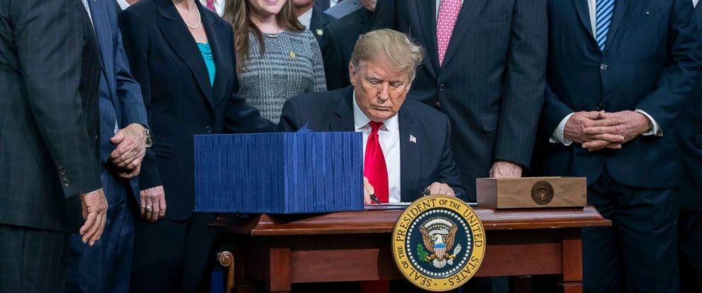PHOTO: President Donald Trump signs the Agriculture Improvement Act of 2018 farm bill at the White House in Washington, Dec. 20, 2018.