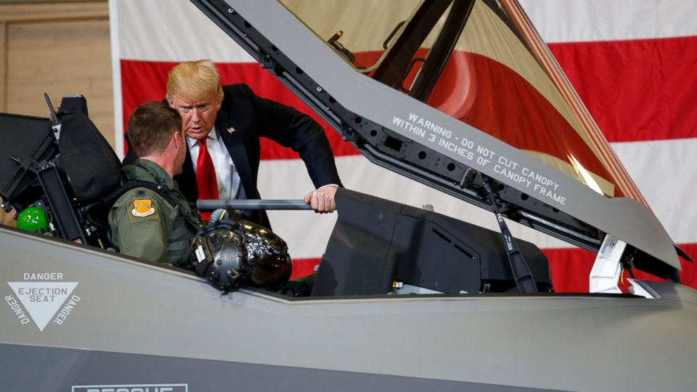 President Donald Trump talks to a pilot in the cockpit of an F-35 aircraft during a Defense Capability Tour at Luke Air Force Base, Ariz., Friday, Oct. 19, 2018.