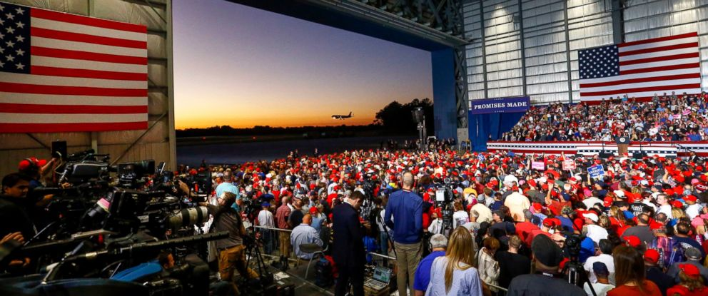 PHOTO: Supporters watch as Air Force One lands outside the hanger where they wait for President Donald Trump to speak at a rally, Saturday, Nov. 3, 2018, in Pensacola, Fla.