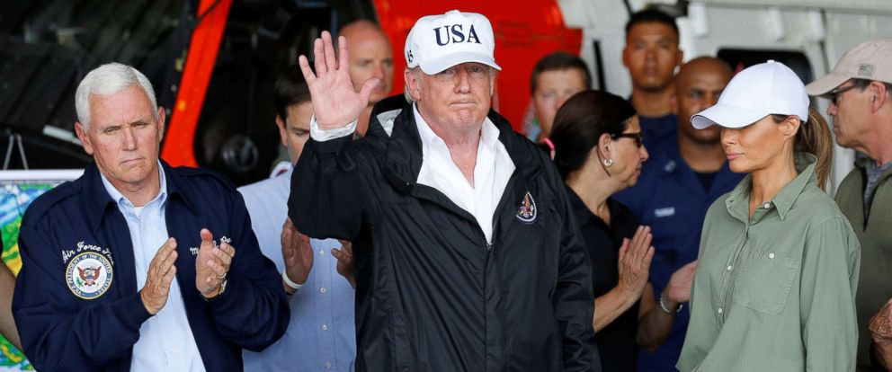 PHOTO: President Donald Trump waves after attending a briefing with Vice President Mike Pence and first lady Melania Trump on Hurricane Irma relief efforts in Fort Myers, Florida, Sept. 14, 2017.