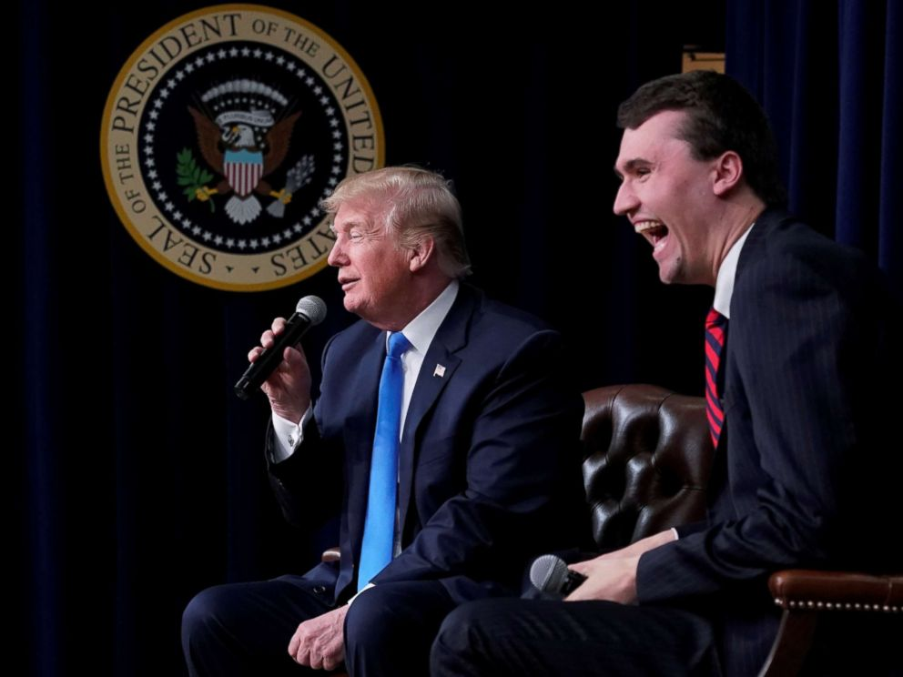 PHOTO: Charlie Kirk, founder of Turning Point USA, laughs after President Donald Trump said that if he could go back in time and give himself advice at age 25 it would be to not run for president, during a youth forum at the White House, March 22, 2018.
