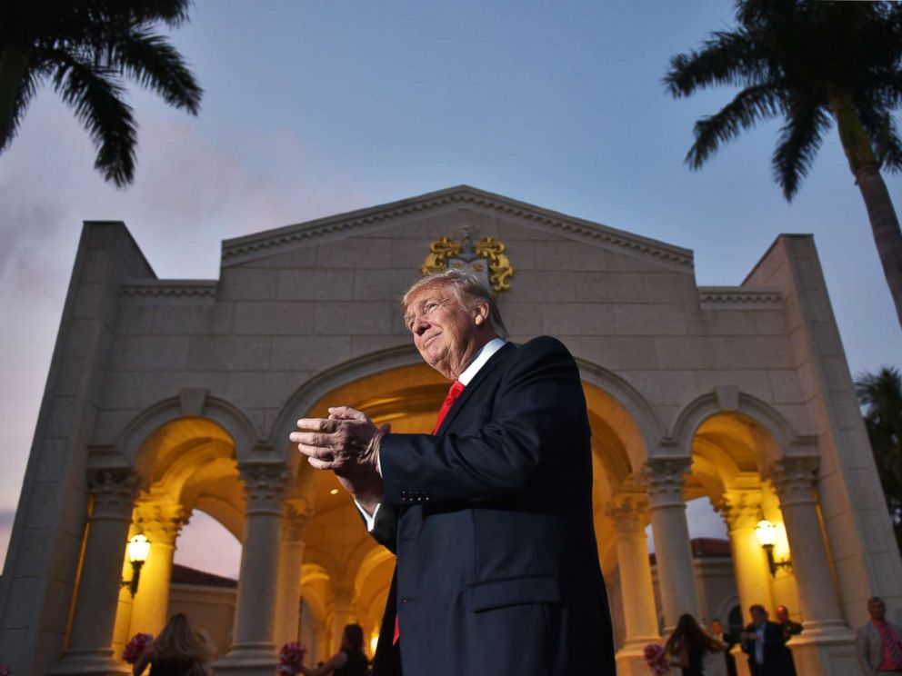 PHOTO: President Donald Trump watches the Palm Beach Central High School marching band perform as it greets him upon his arrival to watch the Super Bowl at Trump International Golf Club Palm Beach in West Palm Beach, Fla., Feb. 5, 2017.