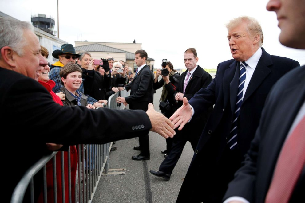 PHOTO: President Donald Trump greets supporters as he arrives aboard Air Force One en route to address a Republican congressional retreat, at Greenbrier Valley Airport in Lewisburg, West Va., U.S., Feb. 1, 2018.