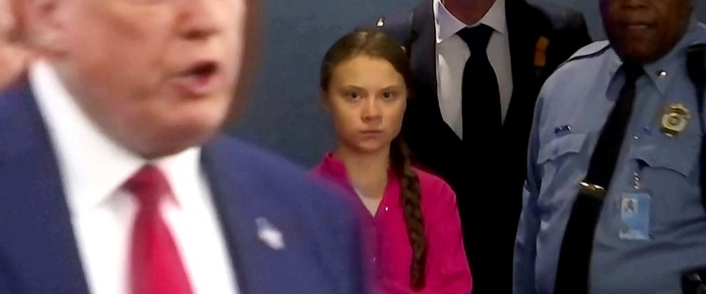 PHOTO: Swedish environmental activist Greta Thunberg watches as President Donald Trump enters the United Nations to speak with reporters in a still image from video taken in New York, Sept. 23, 2019.