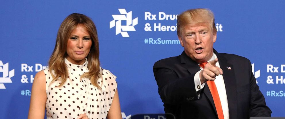 PHOTO: Alongside first lady Melania Trump, President Donald Trump points at members of the audience after a speech at the Rx Drug Abuse & Heroin Summit on April 24, 2019, in Atlanta.