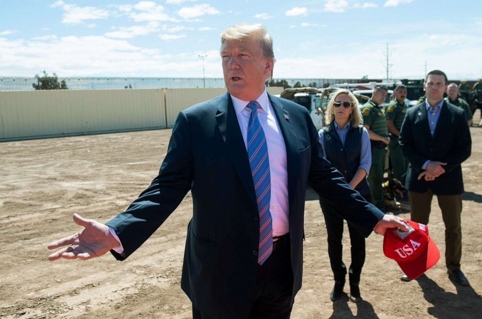 PHOTO: President Donald Trump speaks with members of the US Customs and Border Patrol as he tours the border wall between the United States and Mexico in Calexico, Calif., April 5, 2019.