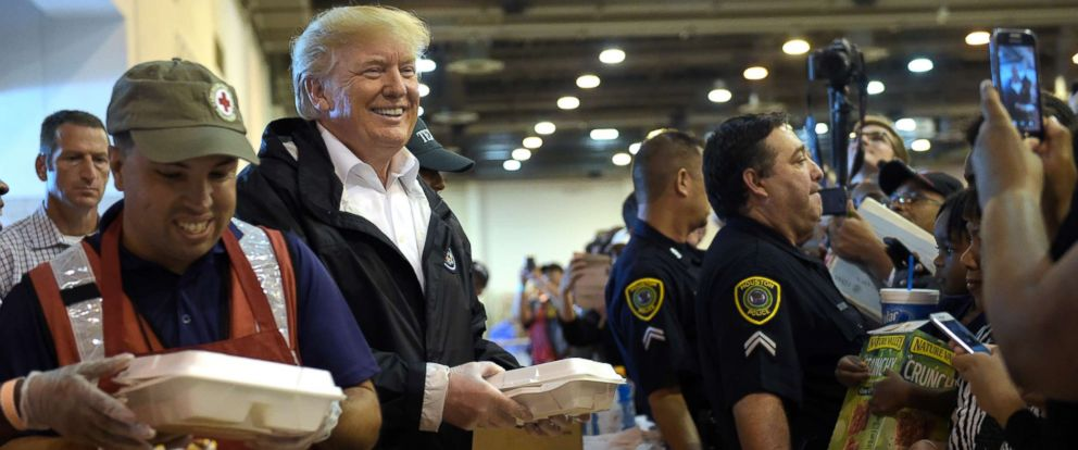 PHOTO: President Donald Trump helps distribute food to people impacted by Hurricane Harvey during a visit to the NRG Center in Houston, Sept. 2, 2017.