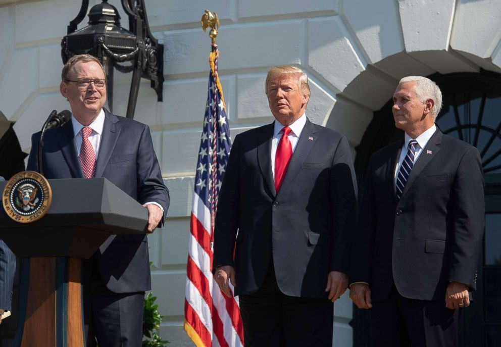 PHOTO: Kevin Hassett, Chair of the Council of Economic Advisers, speaks about the economy as President Donald Trump and Vice President Mike Pence listen, July 27, 2018, on the South Lawn of the White House.