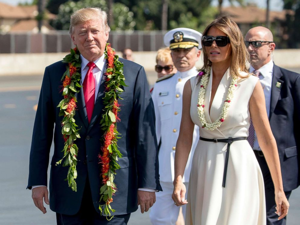 PHOTO: President Donald Trump and first lady Melania Trump wear leis as they arrive at Joint Base Pearl Harbor Hickam, Hawaii, Nov. 3, 2017.