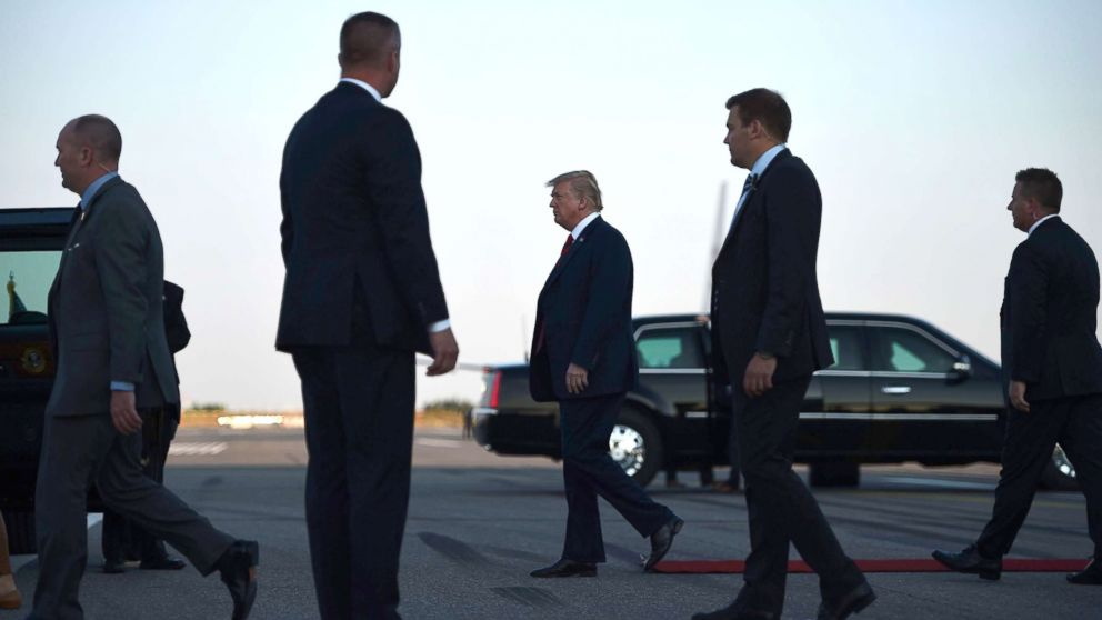 US President Donald Trump walks towards the Presidential car upon arrival at Helsinki-Vantaa Airport in Helsinki, July 15, 2018, on the eve of a summit in Helsinki between the US President and his Russian counterpart.