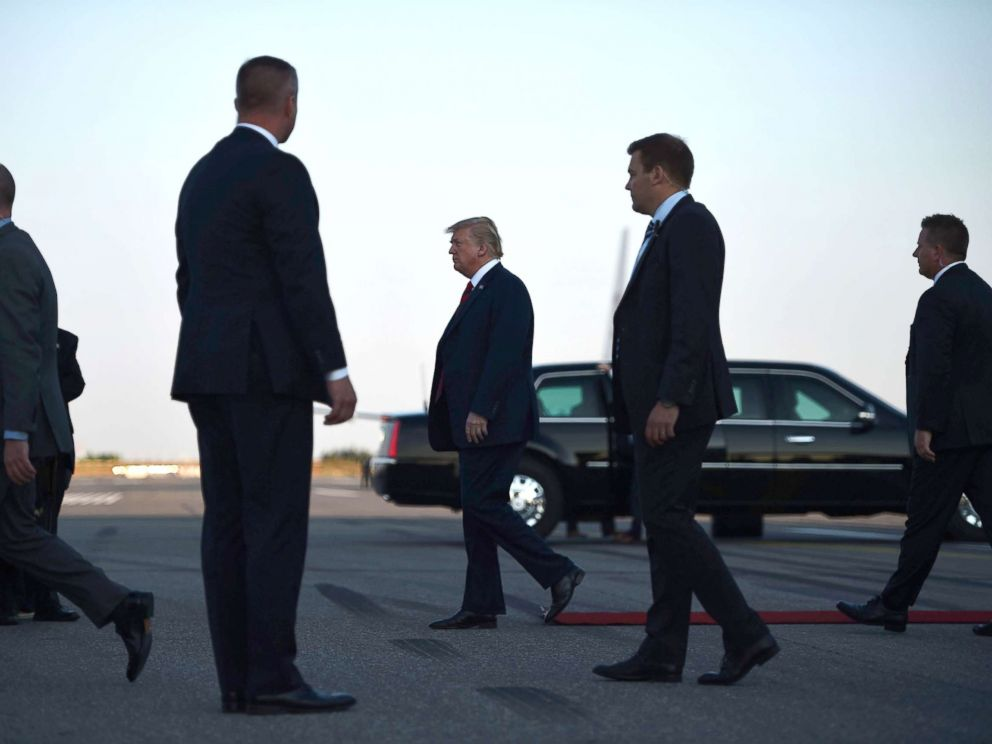 PHOTO: US President Donald Trump walks towards the Presidential car upon arrival at Helsinki-Vantaa Airport in Helsinki, July 15, 2018, on the eve of a summit in Helsinki between the US President and his Russian counterpart.