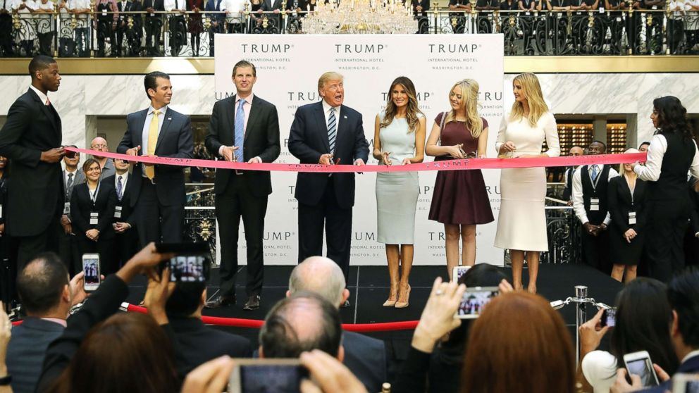 Republican presidential nominee Donald Trump and his family (L-R) son Donald Trump Jr, son Eric Trummp, wife Melania Trump and daughters Tiffany Trump and Ivanka Trump cut the ribbon at the new Trump International Hotel, Oct. 26, 2016, in Washington, DC.
