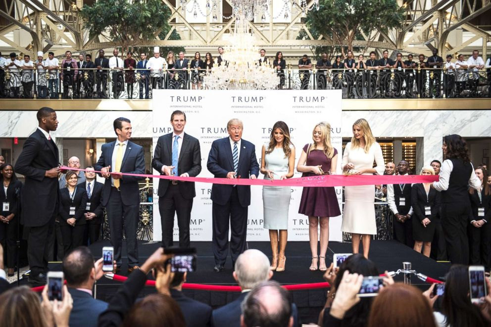 PHOTO: In this file photo, Donald Trump, accompanied by Donald Trump Jr., Eric Trump, Tiffany Trump, Melania Trump and Ivanka Trump, cut a ribbon during the grand opening ceremony of the Trump International Hotel in Washington, D.C., Oct. 26, 2016.