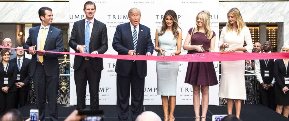 PHOTO: Donald Trump, accompanied by Donald Trump Jr., Eric Trump, Tiffany Trump, Melania Trump, and Ivanka Trump, cut a ribbon during the grand opening ceremony of the Trump International Hotel- Old Post Office in Washington, D.C. on Oct. 26, 2016.