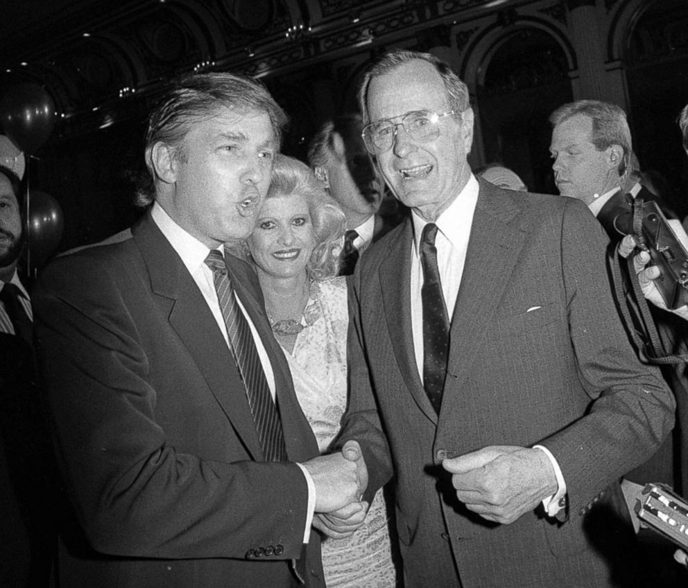 PHOTO: Donald Trump and his wife Ivana join Vice President George Bush in the ballroom of the Plaza Hotel during a fundraiser for Mr. Bushs presidential campaign.