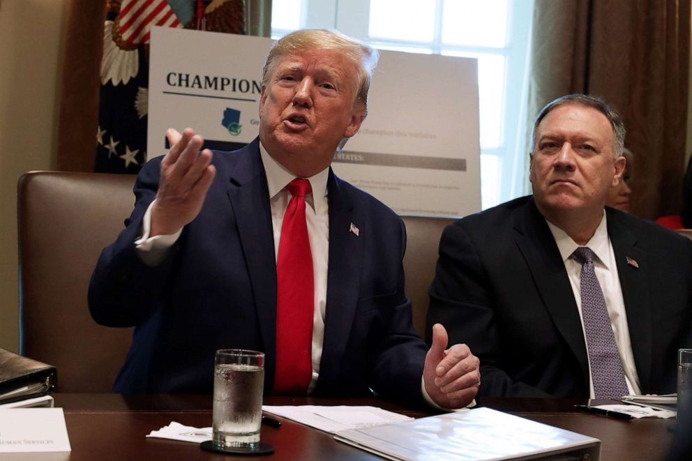 PHOTOS: US President Donald Trump speaks as Secretary of State Mike Pompeo listens during a cabinet meeting at the White House Cabinet on October 21, 2019 in Washington, DC.