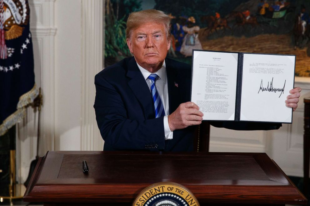 PHOTO: President Donald Trump shows a signed Presidential Memorandum after delivering a statement on the Iran nuclear deal from the Diplomatic Reception Room of the White House, May 8, 2018, in Washington.