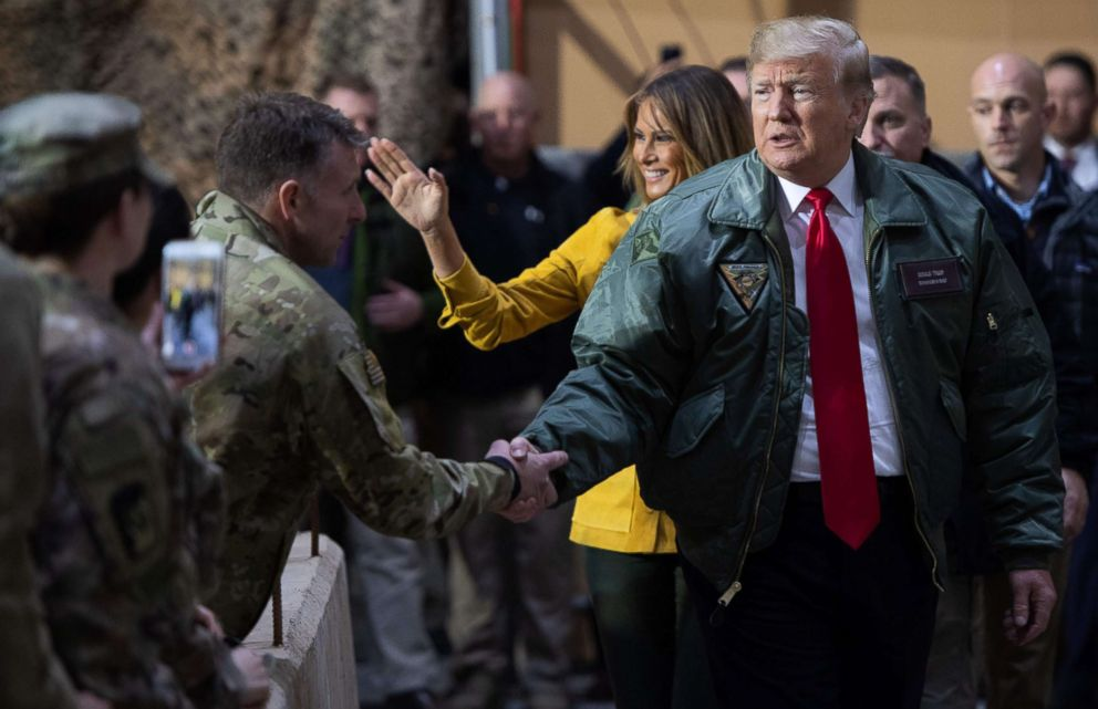 PHOTO: President Donald Trump and first lady Melania Trump arrive to speak to members of the U.S. military during an unannounced trip to Al Asad Air Base in Iraq on Dec. 26, 2018.