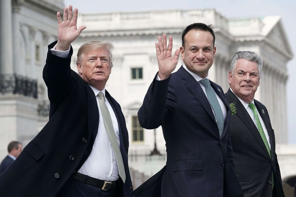 President Donald Trump and Irish Prime Minister Leo Varadkar wave as U.S. Rep. Peter King (R-NY) (R) looks on after the Friends of Ireland luncheon March 15, 2018, on Capitol Hill.