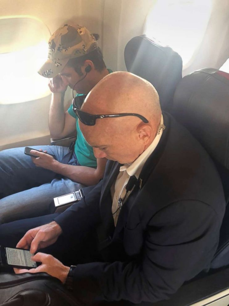 PHOTO: Donald Trump Jr. seated near the window on a flight to Westchester, N.Y., July 27, 2018.