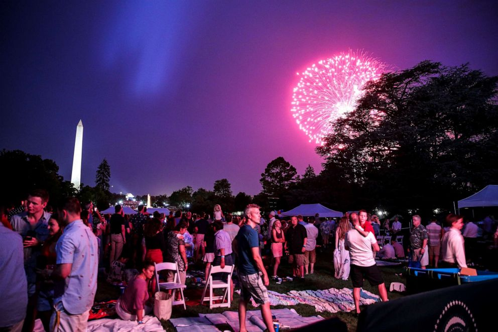 PHOTO: Guests watch a fireworks display on the South Lawn of the White House on July 4, 2018 in Washington, D.C.