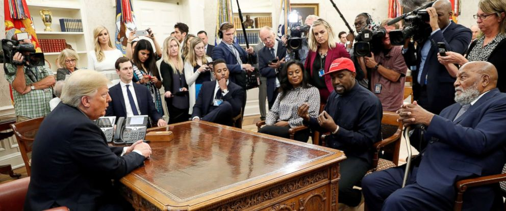 PHOTO: President Donald Trump listens as rapper Kanye West speaks during a meeting in the Oval Office at the White House, Oct. 11, 2018.