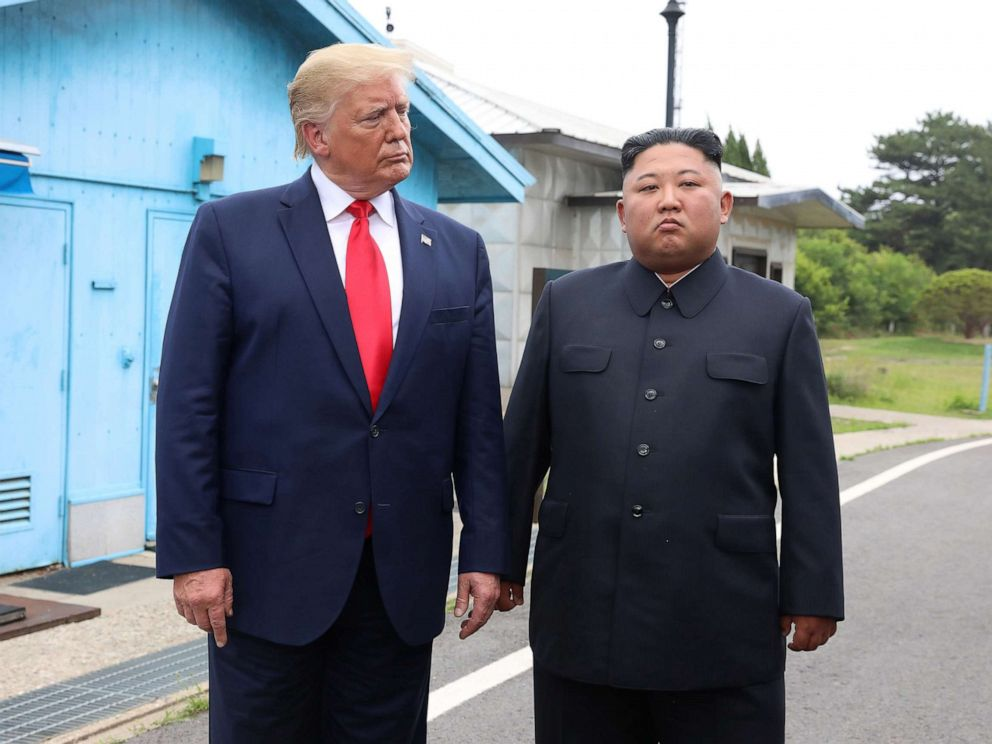 PHOTO: President Donald Trum and North Korean leader Kim Jong Un meet in the demilitarized zone (DMZ) separating the South and North Korea on June 30, 2019 in Panmunjom, South Korea.