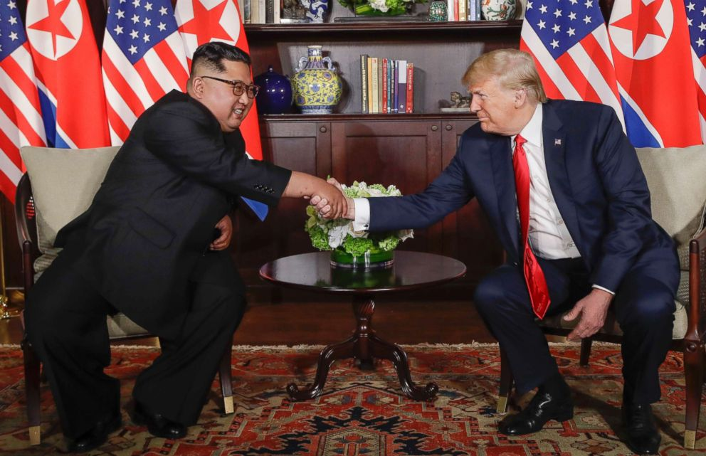 PHOTO: President Donald Trump shakes hands with North Korea leader Kim Jong Un during their first meetings, June 12, 2018 in Singapore.
