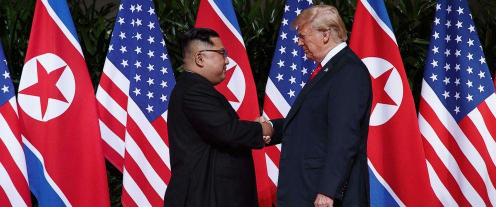 PHOTO: President Donald Trump shakes hands with North Korean leader Kim Jong Un on Sentosa Island, June 12, 2018, in Singapore.