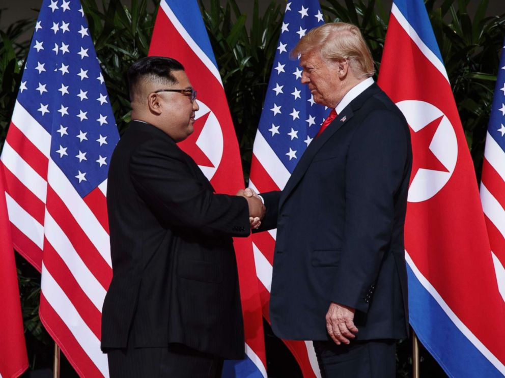 PHOTOS: Trump goes face to face with Kim in historic summit with North Korea