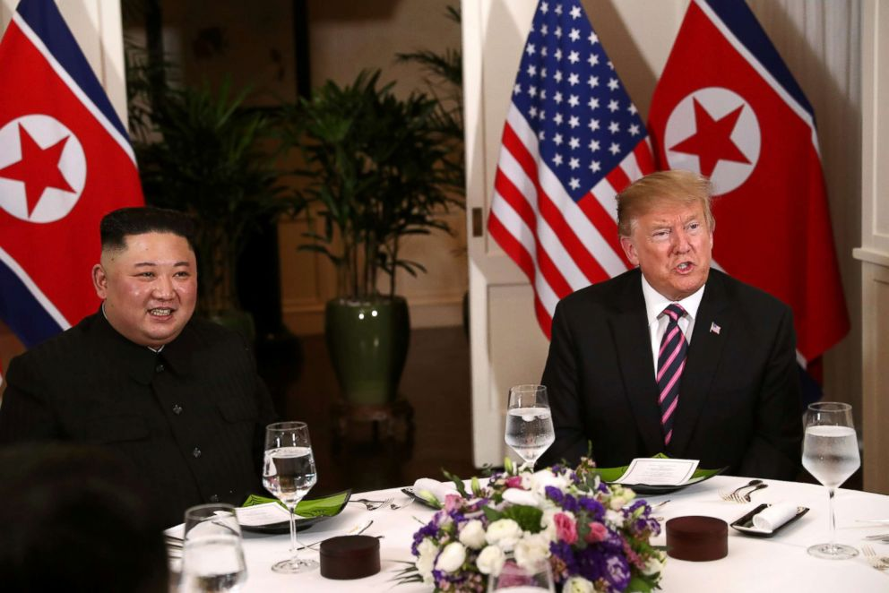 North Korean leader Kim Jong Un and President Donald Trump sit down for a dinner during the second U.S.-North Korea summit at the Metropole Hotel in Hanoi, Vietnam Feb. 27, 2019.