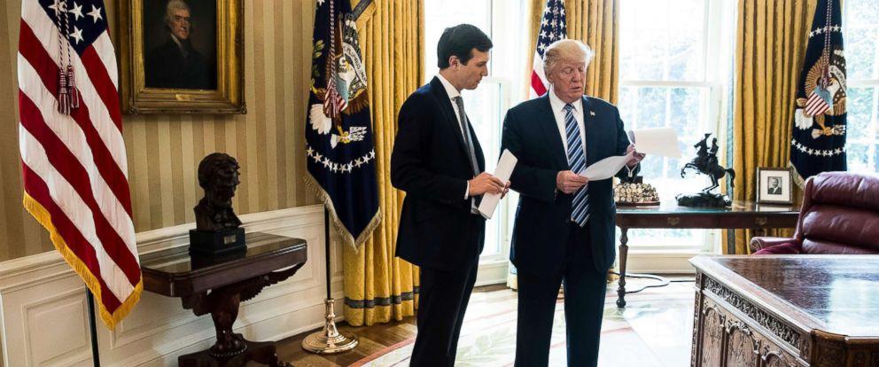 PHOTO: President Donald Trump speaks to White House Senior Adviser Jared Kushner, left, in the Oval Office in Washington, D.C., April 21, 2017.