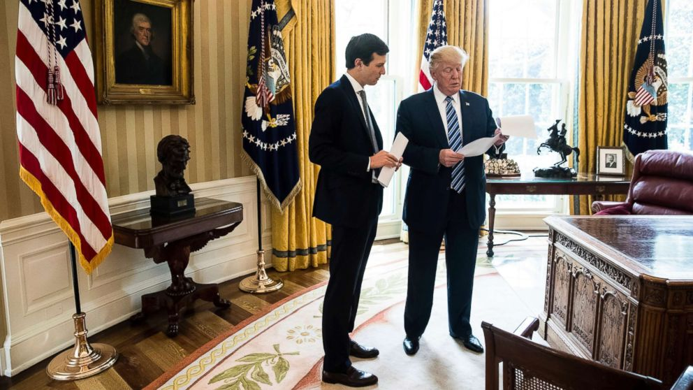 President Donald Trump speaks to White House Senior Adviser Jared Kushner, left, in the Oval Office in Washington, D.C., April 21, 2017.