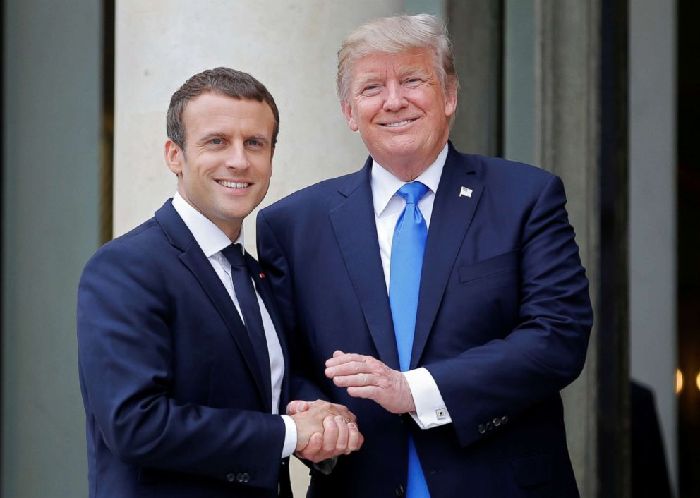 PHOTO: French President Emmanuel Macron greets President Donald Trump at the Elysee Palace in Paris, July 13, 2017.