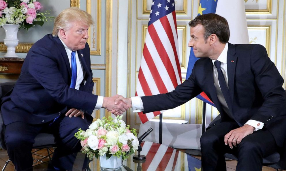 PHOTO: President Donald Trump and French President Emmanuel Macron shake hands during a meeting in Normandy, France, June 6, 2019.