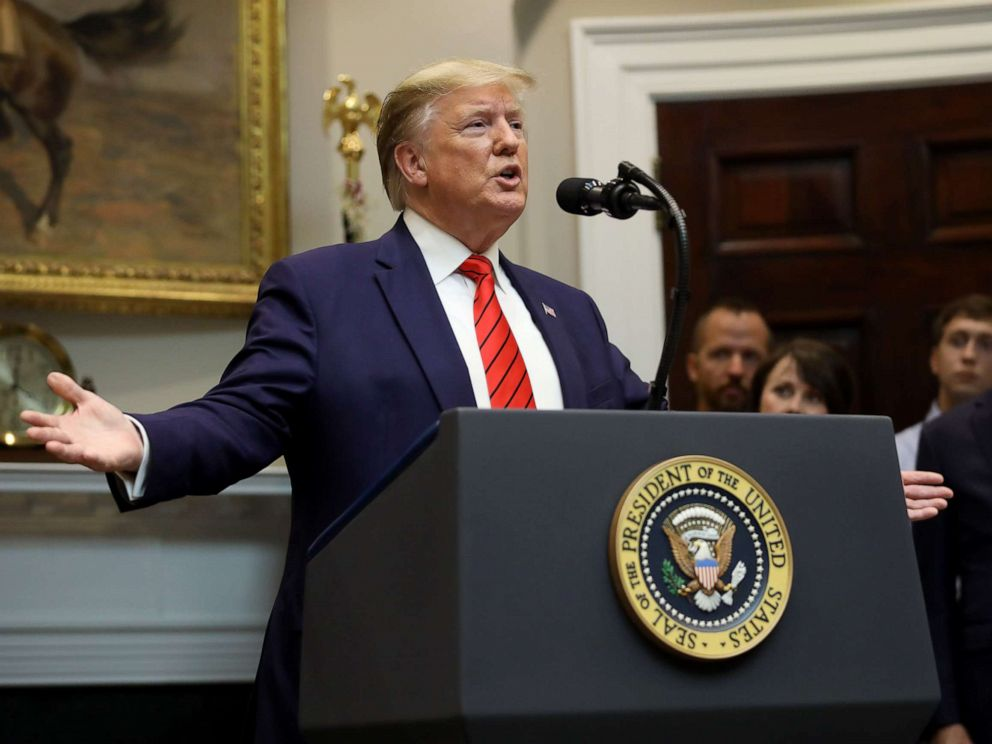PHOTO: U.S. President Donald Trump responds to a question from a reporter at an event for the signing of two executive orders aimed at greater governmental transparency at the White House Oct. 9, 2019 in Washington, D.C.