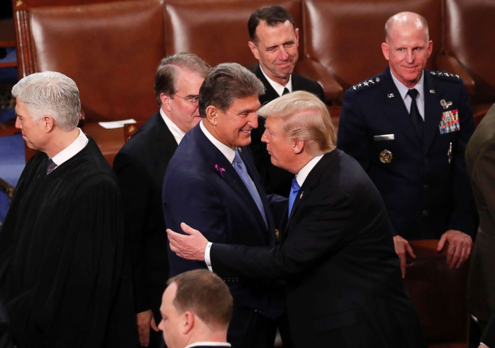 PHOTO: President Donald Trump hugs Democratic Senator from West Virginia Joe Manchin as he departs after delivering his State of the Union address to a joint session of the U.S. Congress on Capitol Hill in Washington, Jan. 30, 2018.