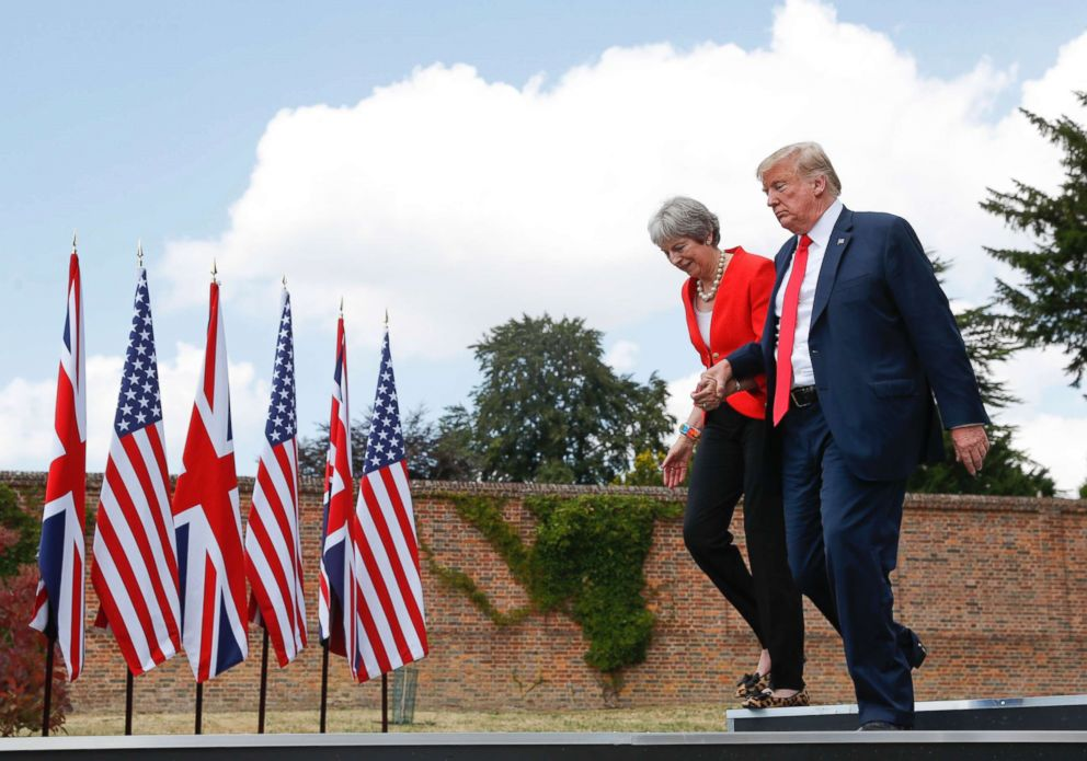PHOTO: President Donald Trump and British Prime Minister Theresa May hold hands at the conclusion of their joint news conference at Chequers, in Buckinghamshire, England, July 13, 2018.